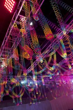 Rainbow slinky ceiling ~that would be cool for a youth center!
