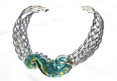 Woven sterling silver collar with original borosilicate glass...courtesy of accessoreez.com