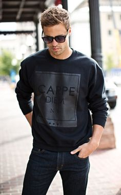 Shop this look on Lookastic:  http://lookastic.com/men/looks/black-sunglasses-black-print-crew-neck-sweater-navy-jeans/8512  — Black Sunglasses  — Black Print Crew-neck Sweater  — Navy Jeans