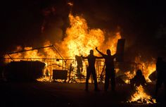 Riot police battled protesters in at least five cities, with some of the most intense clashes happening in Rio de Janeiro, where an estimated 300,000 demonstrators swarmed into the seaside city's central area. (AP Photo/Victor R. Caivano)