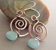 Swirly hoop copper earrings with blue aquamarine coloir jade stones.