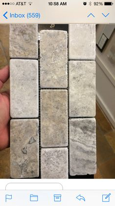Kitchen Backsplash  -  Ancient Tumbled Silver 2x4 Travertine grout Warm Gray