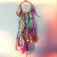 Doily dream catcher. Feathers. Crafts. Love it!