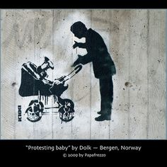"Street art on the back of Bergen Art Museum along Lars Hilles gate in Bergen, Norway. The stencil features a protesting baby using a megaphone.  Dolk Lundgren, or simply Dolk (Norwegian for dagger/knife), is a Norwegian stencil artist whose work has  Made by streetartist ""Dolk"" - #streetart #aryz - Click for more streetart"