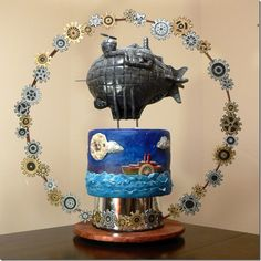 http://betweenthepagesblog.typepad.com/between-the-pages-blog/2011/07/steampunk-blimp.html#  Steampunk Cake