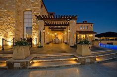 Another excellent view of the backyard. Love the architecture, color scheme and landscaping.   Source: Malibu Rocky Oaks Vineyard | Hilton Hyland