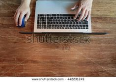 close up hand finger type laptop keyboard,  Hands multitasking working on laptop connecting internet and sitting at wooden table. management concept for achievement business strategy