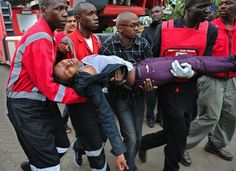 Kenya Terror Attack | A woman in shock after being held hostage was taken to safety. At least 68 people were killed and more than 150 injured when Islamic militants stormed Nairobi's Westgate shopping centre on 21 September taking patrons hostage. Only Muslims who were able to prove their religion were allowed to leave the mall. A Somalian militant group, al-Shabaab, claimed responsibility for the gun attack on Twitter. Photo: AFP / Getty Images