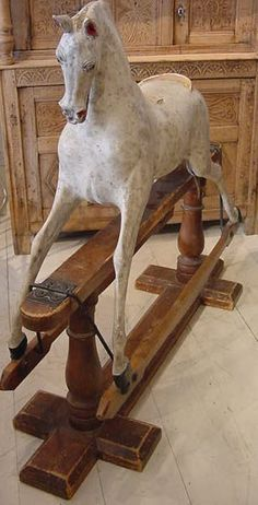 Shabby rocking horse. I would LOVE to have this!