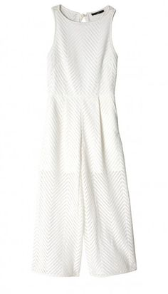 Embrace warm weather whites in the Tibi Blanca Lace Jumpsuit. The lace overlay makes for a standout style that's fit to wear in the hottest exotic locales.