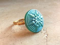 Hey, I found this really awesome Etsy listing at http://www.etsy.com/listing/125326477/blue-button-ring-geometric-starburst