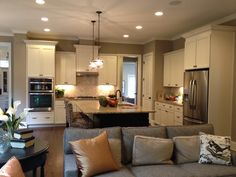 Dream Open concept kitchen with white or cream cabinets and an island