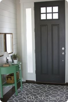 For a bold look that blends well with neutrals and complements brighter tertiary colors, try a dark, rich tone like Urbane Bronze SW We love how well it suits the front door pictured here. Door Paint Colors, Front Door Colors, Urbane Bronze Sherwin Williams, Dark Doors, Painted Front Doors, Internal Doors, Home Design, Interior Design, House Colors