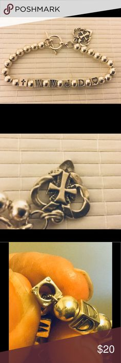 ".925 Sterling Silver WWJD Bracelet with Charm A very nice silver bracelet with 4 mm silver balls and 5 mm letter cubes that ask "" What Would Jesus Do"":  the bracelet measures 7 1/2"". The links holding the bracelet together are a silver chain. Very well made and sturdy. The charm is heart shaped with a cross inside, marked .925 Silver Jewelry Bracelets"
