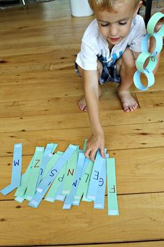 handsonaswegrow: Learn the alphabet with paper chains, plus how to make a paper chain reusable numbers too maybe their name