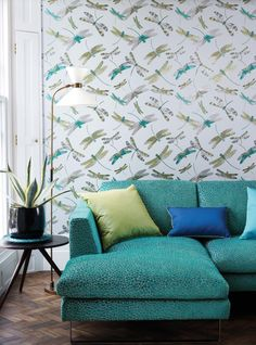 Matthew Williamson in collaboration with Osborne & Little. The Dragonfly Dance wallpaper from the 2015 Samana collection. A signature pattern from Matthew's fashion collection. A home decorated with green furniture.
