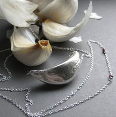 silver garlic necklace. Not going to lie, it would be a great vampire prop...