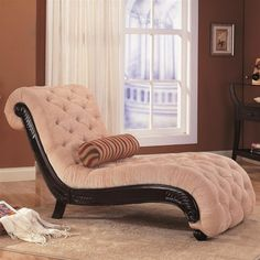 The luxurious chaise features scroll design with dark finish carved wood trim and button tufted accents on the fabric. Description from classicsofabed.com. I searched for this on bing.com/images