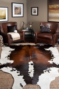 Image from http://www.examsuites.com/wp-content/uploads/2015/01/decoration-astounding-interior-decorations-with-lavish-dark-brown-leather-chairs-and-black-end-table-featuring-cow-skin-rug-with-jute-soft-animal-skin-rug-inspirations-for-your-interior-decorations.jpg.