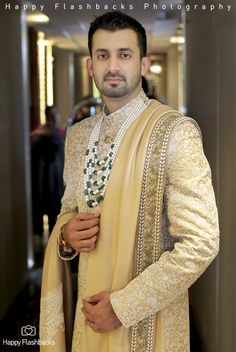 Keeping it stylish with intricately embroidered ivory sherwani and pearl and emerald strings.