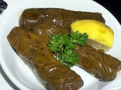 Recipe for yalanji (Stuffed Vine Leaves) - learn how to make delicious yalanji and bring the taste of middle eastern cuisine to your kitchen. Yummy Lebanese side dish!!