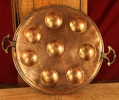 1850s escargot poaching pan (smaller inserts). awwwesome wall hanging or from kitchen beams!!!!