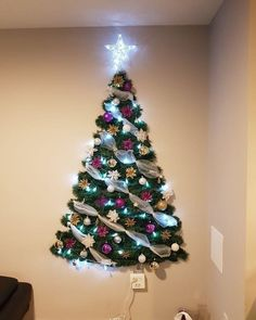 In order to have the perfect Christmas, do you consider decorating the wall? Check out these Amazing and within budget DIY Christmas wall tree decoration ideas… Tinsel Christmas Tree, Creative Christmas Trees, Christmas Love, Xmas Tree, Christmas Lights, Christmas Crafts, Merry Christmas, Tree Decorations, Christmas Decorations