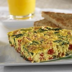 This quick frittata recipe features a colorful trio of vegetables -- onion, spinach and tomatoes flavored with balsamic vinegar