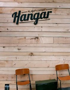 This is it, esto como logo en madera arriba con el letering de intenzzo. Flight Coffee Hangar, Laser Cut Exterior signage on Macrocarpa slats