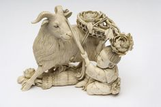 Ivory okimono of a small boy with a goat