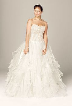 Brides.com: Designer Plus-Size Wedding Dresses We Love. Style 8CWG568, strapless ball gown with organza ruffle skirt, $1,400, Oleg Cassini Collection available at David's Bridal  See more David's Bridal wedding dresses.