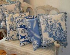 lovely toile pillows on a very cool double back chair upholstered in gingham
