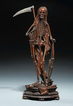 PERSONIFICATION OF DEATH WITH A SCYTHE. Southern German, late 17th / early 18th century. Fruitwood and metal, 36.2 cm., 14¼ in. (Exhibited: Brussels, Musée de la Maison d'Erasme, Anatomie des Vanités, 2008). -Sotheby's-