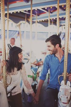 Carousel & Mickey Mouse ears | Engagement session by http://katiepritchardphoto.com