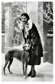 French starlet posing with greyhound,  circa 1920