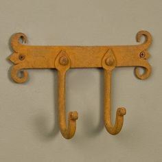 Hand-Forged Iron Spanish Coat Rack with Two Hooks - Rust by Whittington Collection. $21.95. Featuring the classic Spanish coat of arms design, this hand-forged iron coat rack will instantly add an authentic feel to your home. Place near an entryway or hallway for easy access to your coats and hats. Shown in Rust finish. Made of hand-forged iron. Rust finish is actual oxidized iron, and may bleed slightly onto some fabrics. Overall measurements: 7-1/2 L x 5 H. 2 extension f...