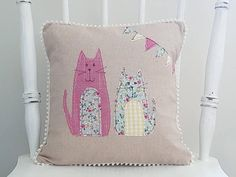 This lovely linen cat cushion cover / linen cat pillow cover would make a lovely gift for cat lovers. This decorative cushion cover featuring cute cats is made of various cotton fabrics appliquéd onto a light beige linen background. Ive used free motion machine embroidery to give