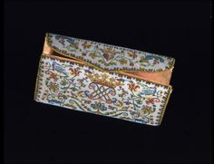 Purse, beadwork embroidery, France. V This purse is inscribed IAME MON ESCLAVAGE and ICY EST MON SECRET, the monogram and motto of Marie Antoinette. The purse may have been associated with her or her court circle.