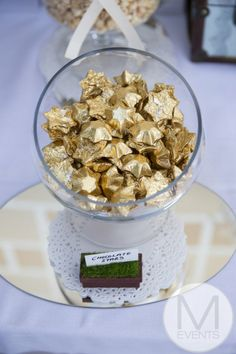 Gold star chocolates for vintage candy bar and small mirror under.