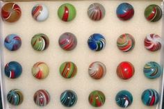 """German Handmade's were one of the earliest type of marbles imported to the United States. These remain one of the most popular of collectible marbles worldwide. There are hundreds of color combinations and styles, but most fall into a handful of categories.  These are """"Banded Opaques"""""""
