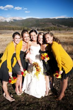 Not the first shrug/cardigan optoin I've seen on bridesmaids. Love it. Black & yellow bridesmaids dresses (photo: Two One Photography)