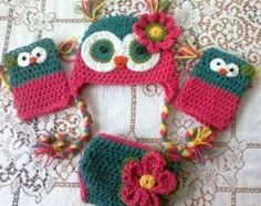 This listing is for an adult size owl hat that is teal and turqoise with lime green accents. The ears are teal feathers. There is a flower to match. This listing is for a child size. Please let me know when ordering what size you want. Thank you for checking out my shop. I look forward to making you something special.