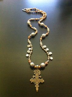 silver and copper coptic cross necklace