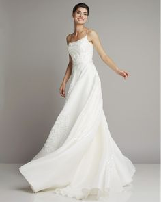 Lightweight slim wedding dress with spaghetti straps and beautiful embroidery ornaments by Giuseppe Papini