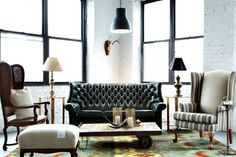 Killer English Tufted sofa.  Love this set up in our studio.
