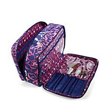 Offering plenty of room for all of your cosmetics and full-sized products, this large beauty bag also has a special spot for your most beloved brushes. The front compartment includes five brush holders on one side and a long zip pocket on the other.
