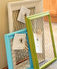 diy -chicken wire on the backs of frames...what a great idea. hang far enough from wall to be able to clip the clothespins. could use this in the kitchen for bills and such.