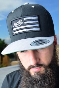 826c3eda530a1 Loyalty Flag Black   Silver Stitch 3D Puff Snapback. Apparel Design ...