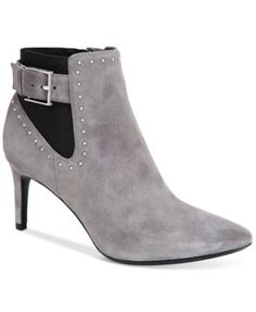 Calvin Klein Women's Jozie Studded Pointed Toe Booties $129.00 Calvin Klein's Jozie booties help you dress to impress day or night. Zip into these studded booties with anything from jeans to a flirty dress.