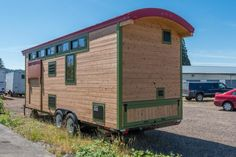 Want proof that living tiny doesn't mean you have to sacrifice luxury, comfort, and style? Look no further than this incredible example. Jenny and Rene Larson built this 24′ long, 8'6″ tall tiny house on wheels that includes all sorts of great design features, but perhaps most impressive are the two slide-out sections that offer them some crucial extra space. All said and done, ...